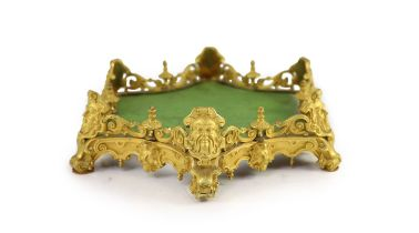 Henry Dasson, an hexagonal ormolu table plateau,mounted with masks and pierced scrolling borders,