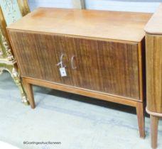 A Gordon Russell Ltd teak and Indian laurel 2 door side cabinet, model R 803 circa 1960, length