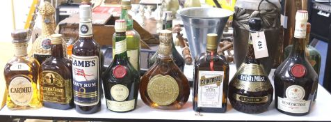 A group of assorted spirits and liqueurs including whisky;Cardhu, Columba cream, Lambs Navy rum,