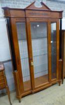 A Biedermeier style ebony inlaid mahogany breakfront display cabinet, W.120cm D.47cm H.197cm