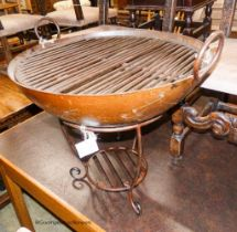 A cast iron fire pit with grill, diameter 67cm, height 65cm
