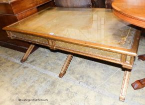 An Italian style gilt and glass 'X' frame coffee table fitted end drawers, length 132cm, depth