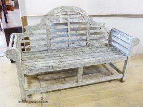 A weathered teak Lutchens style garden bench, length 166cm, depth 57cm, height 100cm