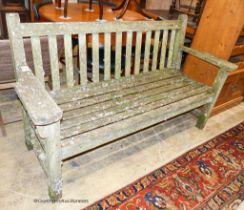 A weathered teak garden bench, length 160cm, depth 56cm, height 90cm