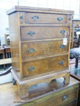 A reproduction George I style walnut bachelor chest, width 59cm, depth 35cm, height 80cm