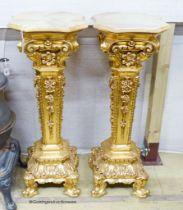 A pair of onyx top gilt pedestals, height 98cm