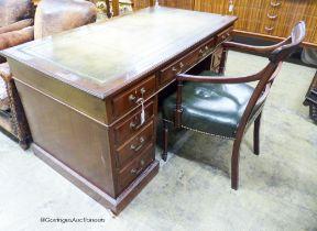 An Edwardian mahogany pedestal desk, length 138cm, depth 75cm, height 74cm together with a George