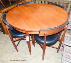 A teak and leatherette Fresco dining suite by Wilkins for G Plan, comprising circular extending