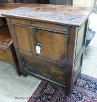 A 17th century oak low cupboard of rectangular form,fitted two cupboards, the upper door off