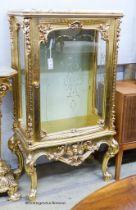 A marble topped gilt vitrine, width 73cm, depth 41cm, height 137cm