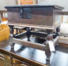 A 17th century oak box stool with hinged rectangular seat, width 46cm, depth 38cm, height 42cm