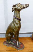A gilt composition seated greyhound, height 78cm