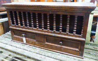 An 18th century and later oak, beech and walnut hanging food cupboard,having spindle front with