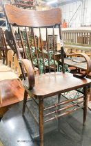 A late Victorian ash and elm comb back elbow chair