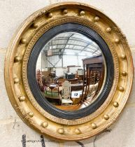 A Victorian giltwood and gesso convex wall mirror, diameter 47cm