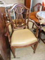 A set of six Hepplewhite style mahogany dining chairs, two with arms