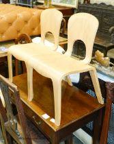 A pair of 'Comunity' ergonomic design children's chairs, 55cm high max.