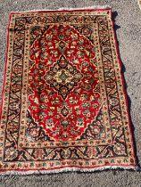 A Kashan rug, 146 x 101cm