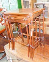 A nest of three Edwardian style inlaid mahogany serpentine tea tables, width 55cm, depth 35cm,