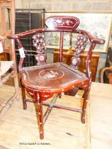 A 20th century Chinese mother of pearl inlaid hardwood corner elbow chair