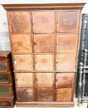 A 19th century mahogany stationery cupboard, width 130cm, depth 47cm, height 204cm