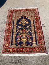 A Qom rug, 150 x 103cm