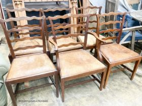 A set of six George III mahogany ladderback dining chairs with leather drop in seats (one with