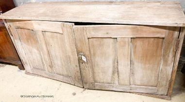 A Victorian pine two door low cupboard, width 122cm, depth 32cm