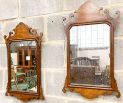 A pair of 18th century style walnut fret cut wall mirrors, width 42cm, height 70cm
