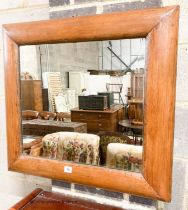 A late Victorian antique style pine cushion mirror, width 70cm, height 66cm
