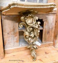 An Italian carved pine gilt console table, width 66cm, depth 38cm, height 67cm