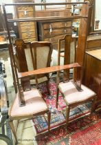 An Edwardian Art Nouveau inlaid mahogany towel rail and a pair of matching salon chairs (3)