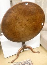 A George III circular mahogany tilt top tea table, diameter 79cm, height 69cm