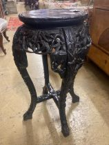 A Chinese carved hardwood marble top vase stand