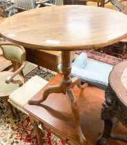 A George III circular mahogany tilt top tea table, diameter 65cm, height 70cm