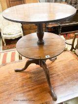 A George III mahogany drop flap two tier dumb waiter, diameter 56cm, height 77cm