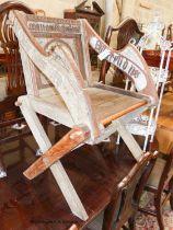 A Glastonbury chair, width 72cm, depth 50cm, height 88cm