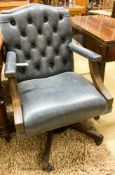 A pair of reproduction beech buttoned blue leather swivel desk chairs, width 60cm, depth 55cm,