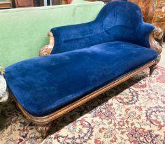 A Victorian carved oak chaise longue, W.180cm D.82cm H.84cm