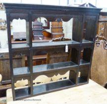 An 18th / 19th century oak three-shelf hanging plate rack, width 107cm, depth 18cm, height 98cm