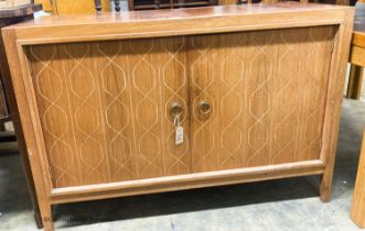 A Gordon Russell teak matrix side cabinet, W.122cm D.46cm H.84cm