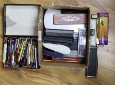 A large collection of pens and pencils, etc.