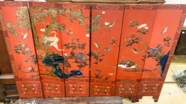 A Chinese red lacquered six fold screen, each panel W.41cm H.184cm