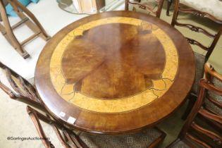 A parquetry inlaid circular centre table, 112cm diameter