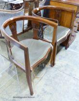 Two Edwardian mahogany tub frame salon chairs