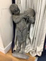 A lead figure of a boy carrying a water pitcher (a.f.),