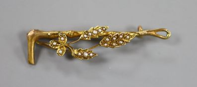 A 9ct gold and seed pearl set riding crop and foliate bar brooch, 47mm, gross weight 2.3 grams.