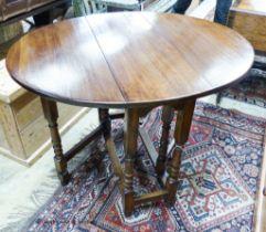 An 18th century style oval oak gateleg table, 100cm extended, depth 83cm, height 74cm