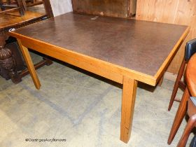 A mid century design Moss & Co rectangular oak writing table circa 1960, length 156cm, depth 95cm,