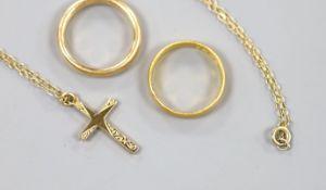 A 22ct god wedding band, 3.7 grams, a yellow meta wedding band, 5 grams and a modern 9ct gold cross